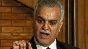 Tarek el-Hachémi lors d'une conférence de presse à Bagdad en février 2011.