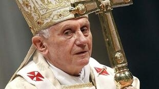 Pope Benedict XVI holds his pastoral cross as he leads the Christmas mass in Saint Peter's Basilica at the Vatican