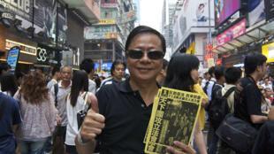 资料图片:黄毓民2011年7月在一次集会活动中。