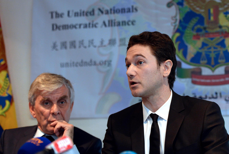 Siwar al-Assad (R) with his lawyer Marcel Ceccaldi, 3 October, 2013