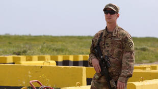 A US soldier at the Qayyarah air base in northern Iraq in March 2020 -- the United States has agreed in talks with Iraq to remove all remaining combat forces deployed to fight Islamic State extremists, although US forces will still provide training