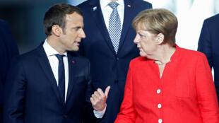 Emmanuel Macron and Angela Merkel at a NATO summit on 25 May 2017.