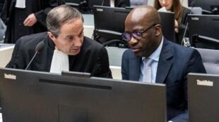 Charles Blé Goudé avec l'un de ses avocats à la Cour Pénale Internationale. La Haye, le 6 février 2020.