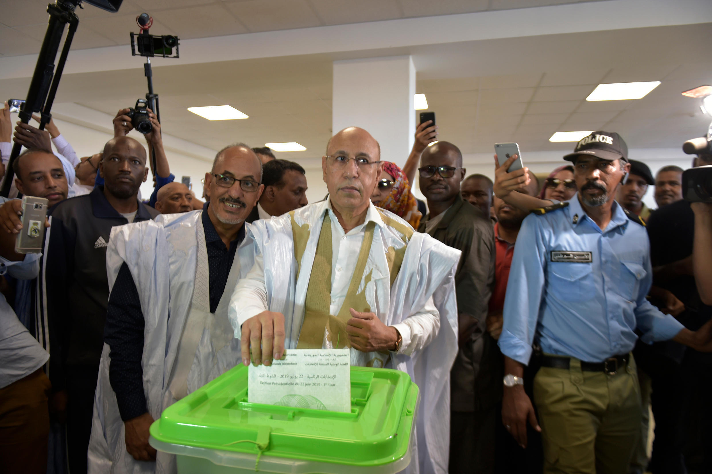 Mohamed Ould Ghazouani (c), voting in Nouakchott, Mauritania. The ruling party candidate was announced the winner on Sunday.