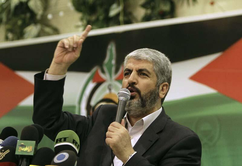 Hamas leader Khaled Meshaal speaks about the Palestinian situation at a charity Iftar meal for Palestinians orphans during the Muslim fasting month of Ramadan at a restaurant near Damascus