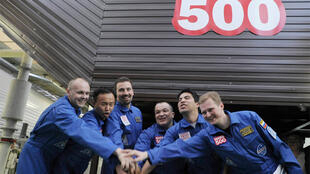 Participants of the Mars500 experiment before entering a confinement module to start their mission in Moscow