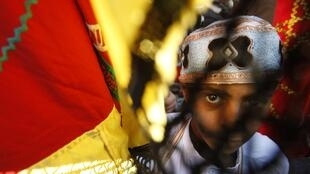A Palestinian boy attends a festival marking the birthday of Prophet Mohammad in the Central Gaza Strip, 4 February, 2012