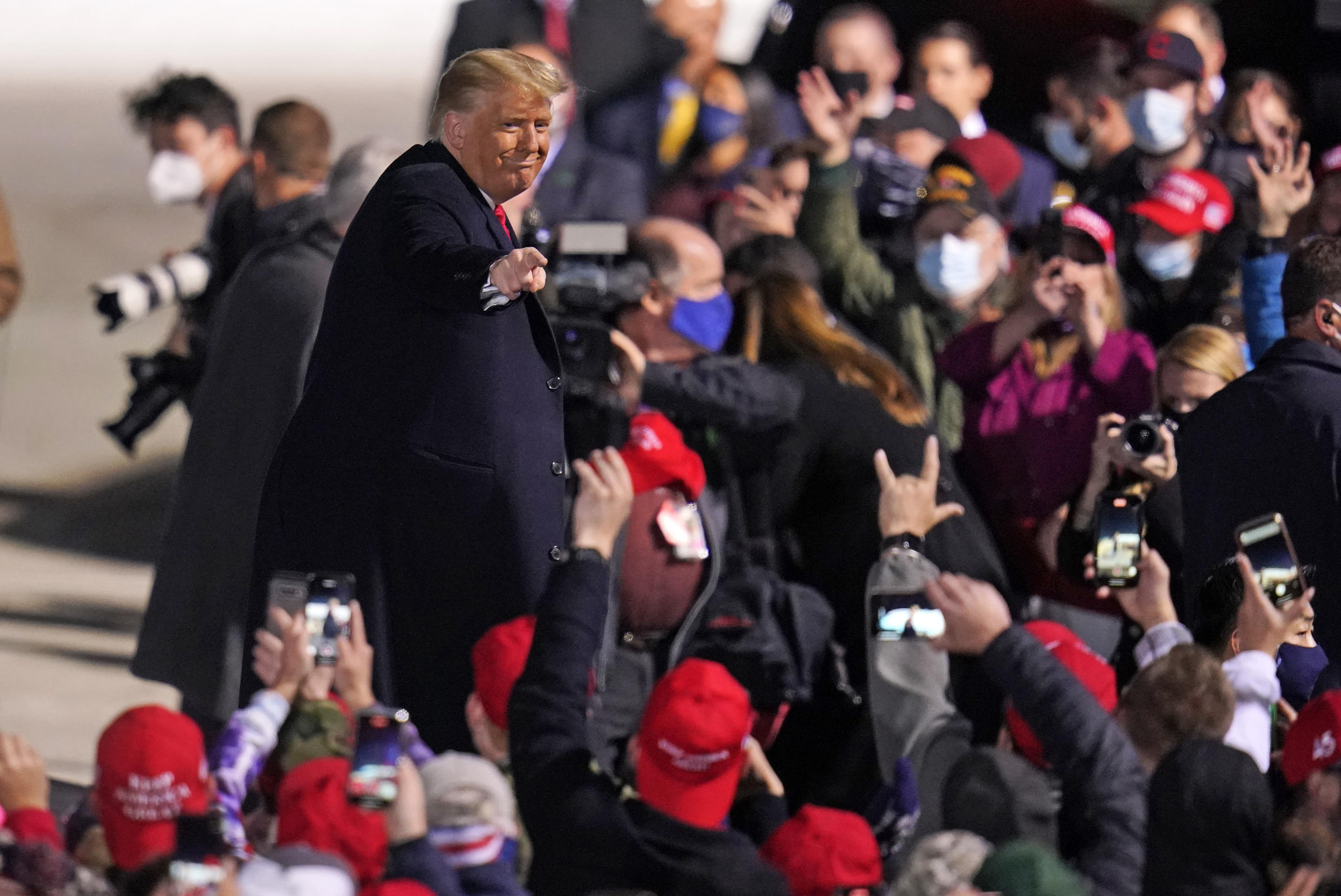 Supporters cheer as President Donald Trump departs following a campaign rally at Erie International Airport, Tom Ridge Field in Erie, Pa, Tuesday, Oct. 20, 2020.