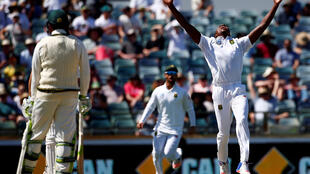 South Africa's Kagiso Rabada celebrates after dismissing Australia's Shaun Marsh in the first Test match on Sunday.