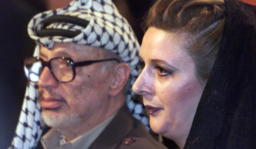 Yasser Arafat và vợ Souha Arafat, năm 1999.