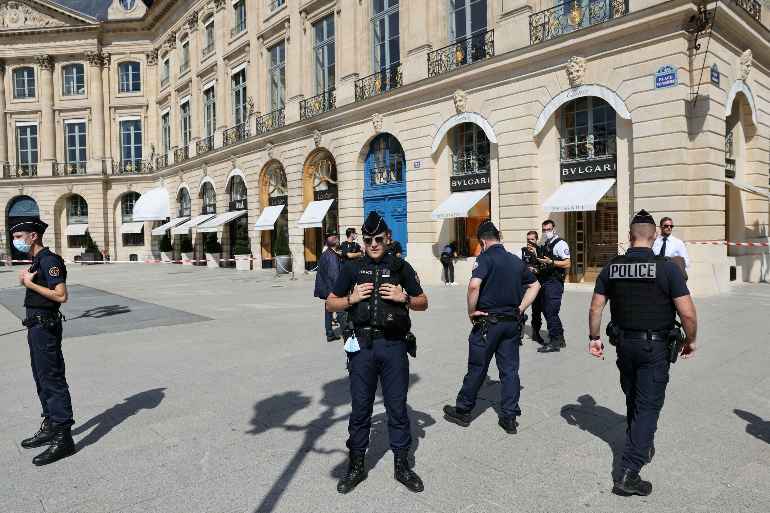 Police officers outside the Bulgari boutique on the Place Vendome in Paris on Tuesday.