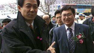資料照片:薄熙來與大連實德董事長徐明。