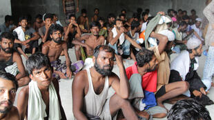 A group of Rohingyas and Bangladeshis rescued by local fishing boats off the coast of Indonesia.