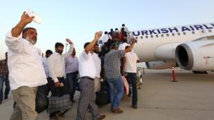 Les chauffeurs turcs à Erbil, au Kurdistan irakien, avant leur départ pour la Turquie, le 3 juillet 2014.