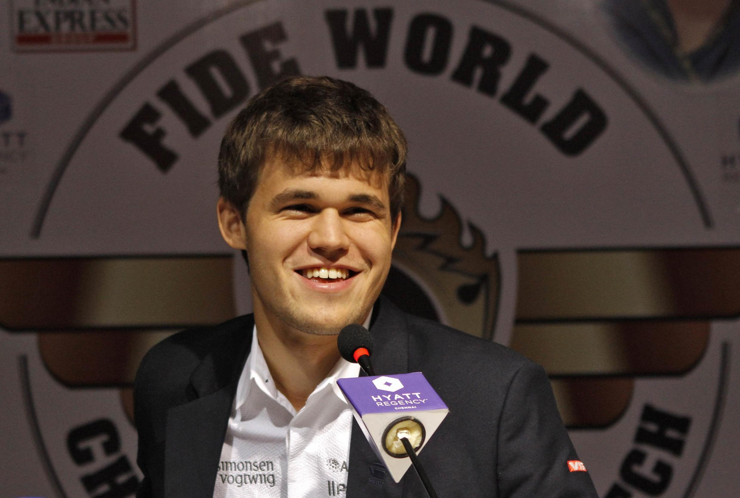 Norway's Magnus Carlsen smiles as he speaks with the media at a news conference after clinching the FIDE World Chess Championship in the southern Indian city of Chennai November 22, 2013.