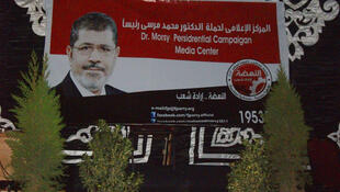 A banner for Mohamed Moursi at the Muslim Brotherhood's headquarters in Cairo