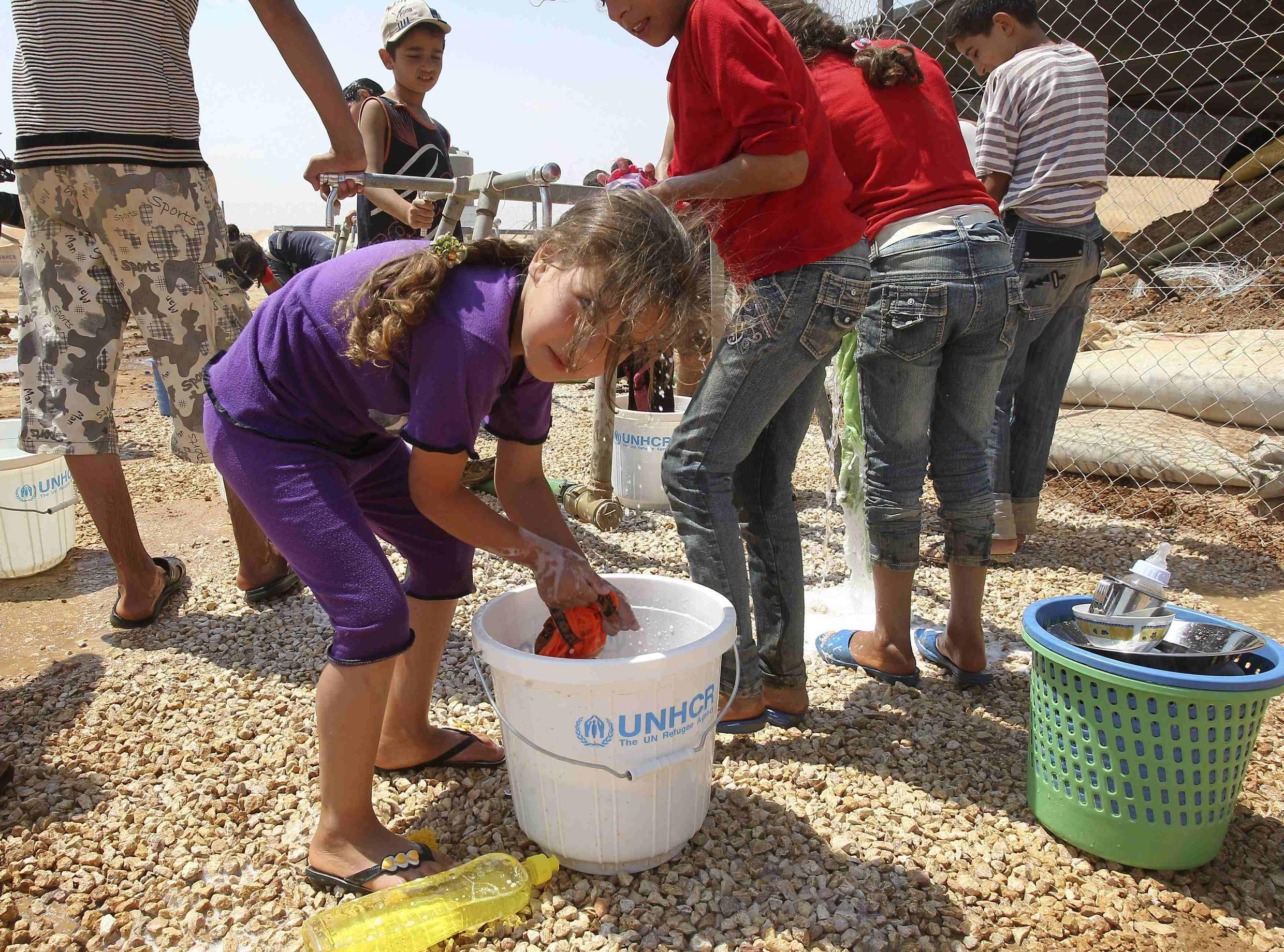 Syrian refugees at the Al Zaatri refugee camp in the Jordanian city of Mafraq, near the border with Syria, 5 August 2012.