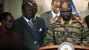 South Sudan's President Salva Kiir (R) addresses a news conference at the Presidential Palace in capital Juba