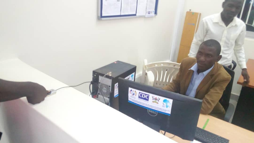 Finger printing patients at Hoima Referral hospital HIV clinic