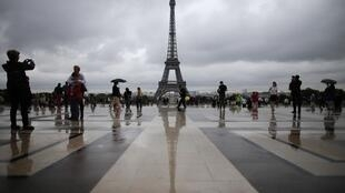 The Eiffel Tower continues to be a big attraction for tourists.