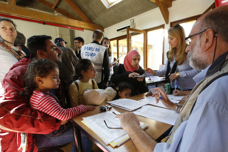 Những người tị nạn Syria và Irak tại phòng khám bệnh ở Cergy Pontoise, ngoại ô Paris, ngày 09/09/2015