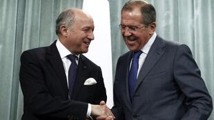French Foreign Affairs Minister Laurent Fabius with Russia's Sergei Lavrov in Moscow on Tuesday