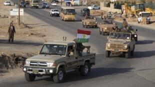 Lực lượng peshmergas (chiến binh Kurdistan ở Irak) trên đường tới thành phố Kobane - REUTERS /Azad Lashkari