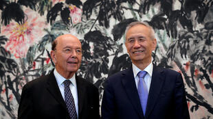 U.S. Commerce Secretary Wilbur Ross, left, chats with Chinese Vice Premier Liu He in 2018