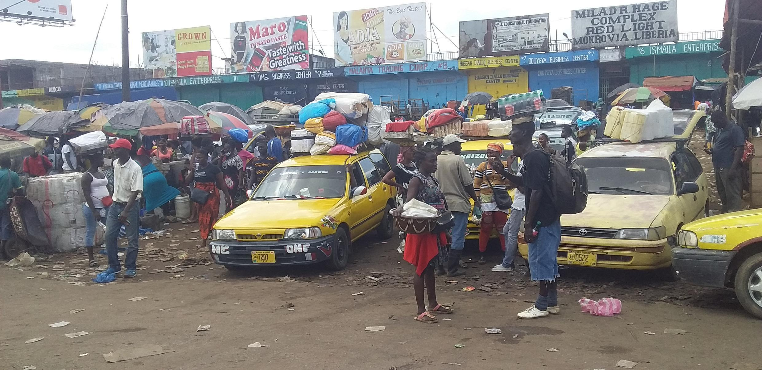 Taxis are piled high at Red Light parking station in Monrovia, Liberia, as many prepare to flee the capital before Covid-19 lockdown