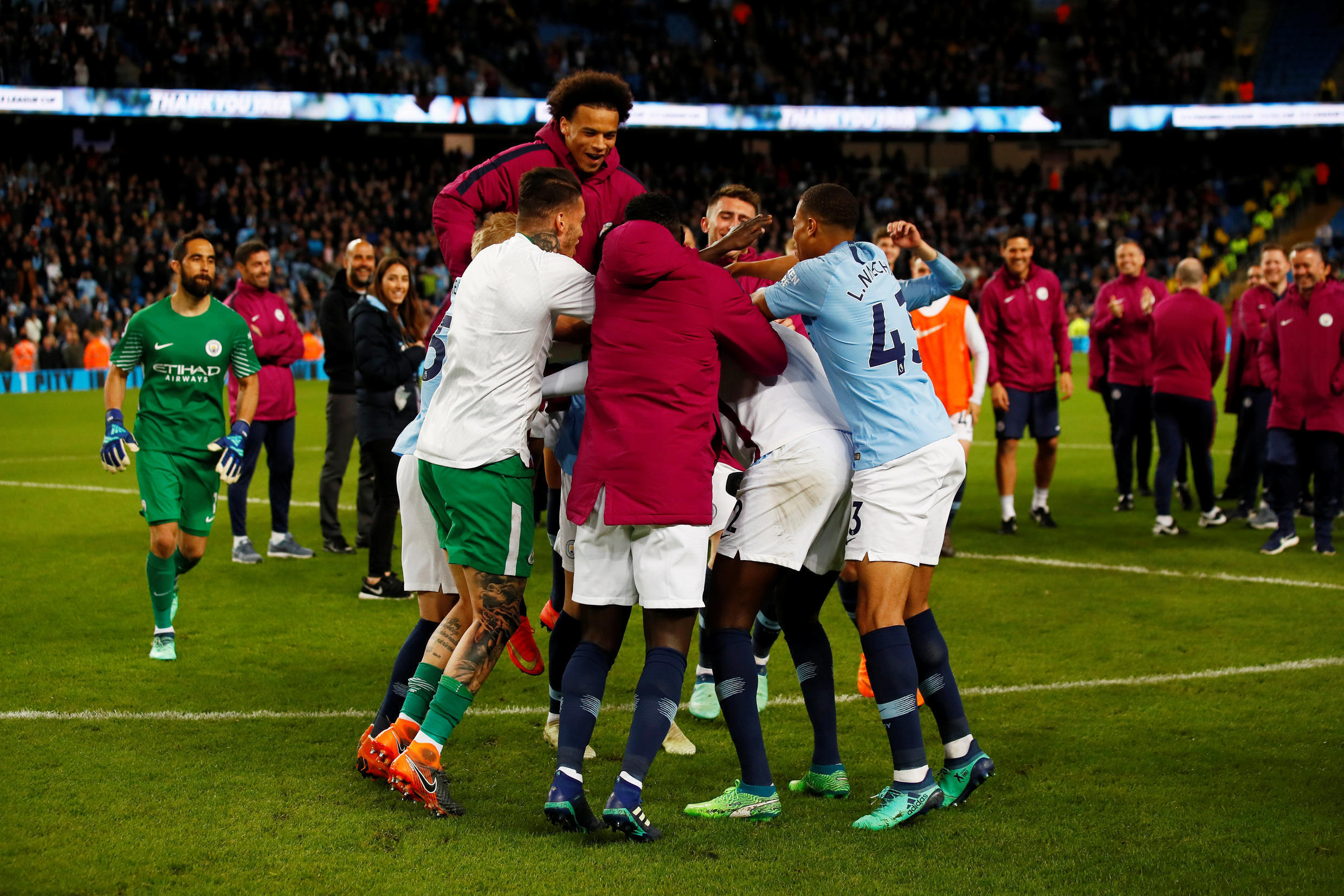 Manchester City's Leroy Sane and team mates hug Yaya Touré during a ceremony after their match against Brighton & Hove Albion on 9 May 2018.