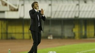 Italy manager Antonio Conte said his players coped well in difficult conditions.