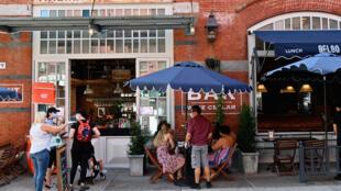 A restaurant in New York's Little Italy neighborhood serves diners outside