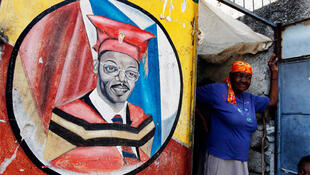 A mural of former Haitian president Jean-Bertrand Aristide is seen in Port-au-Prince, 16 March 2011.