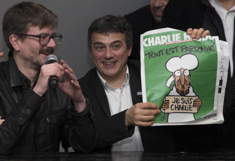 查理周刊編輯部1月13號向媒體展示特刊頭版