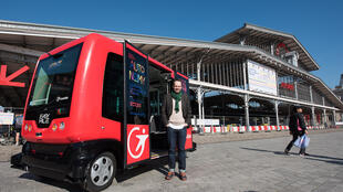 Driverless bus in front of the Urban Mobility fair in La Villette near Paris