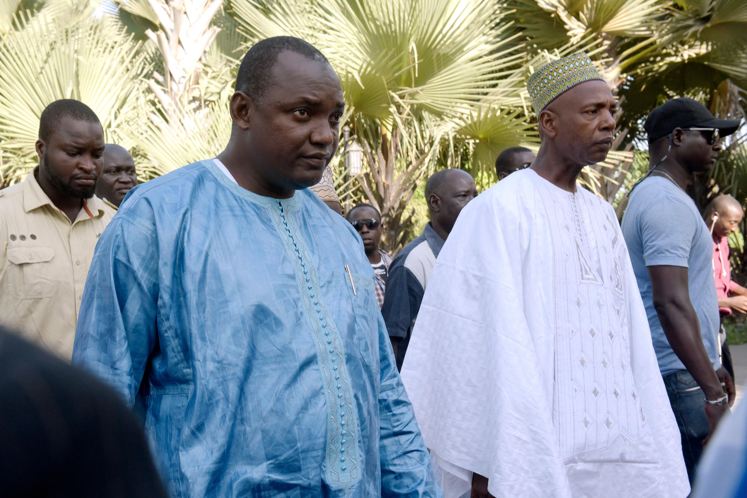 Barrow flanked by his supporters arrives for a meeting with African leaders on 13 December 2016.