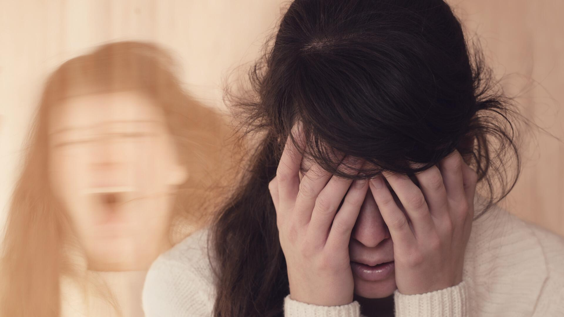 emotional-portrait-of-woman-suffering-from-mental-disorder-picture-id1202320190