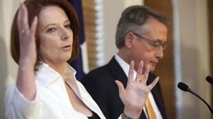 Australia's Prime Minister Julia Gillard speaks during a news conference with Treasurer Wayne Swan in Parliament House, Canberra