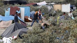 """Migrants in the makeshift camp called """"The New Jungle"""" in Calais in August"""