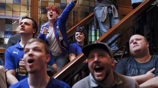Leicester City fans react during their team's soccer match against Manchester United, as they watch the match on television in the Hogarth's pub in Leicester, Britain May 1, 2016.
