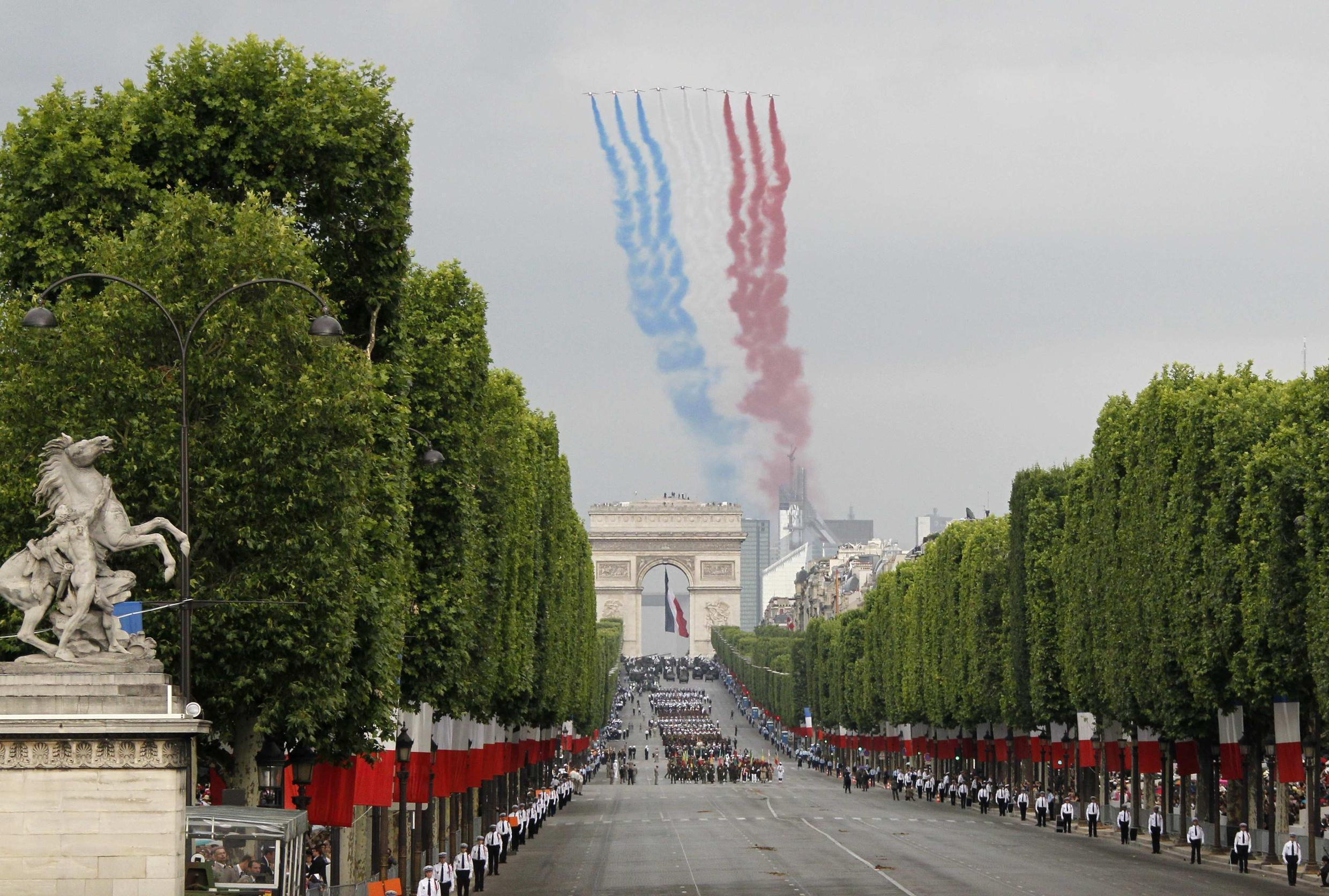 The French air force flies over the Bastille Day military parade, which featured soldiers from 13 African nations.