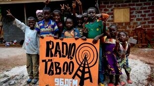 Kids gather around Radio Taboo building, Cameroon