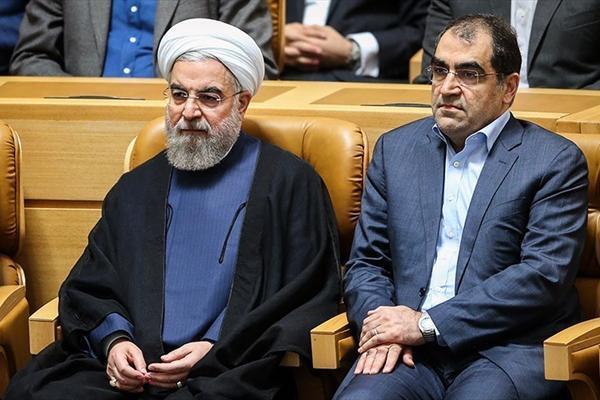 حسن قاضی زاده هاشمی، وزیر بهداست، و حسن روحانی، رئیس جمهوری اسلامی ایران