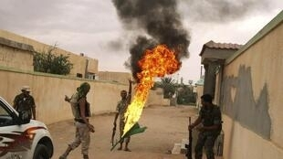 Fighting between Kadhafi and NTC forces continues