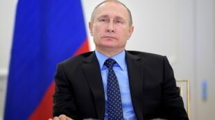 2021-06-15T153425Z_1642804928_RC231O9O4PNQ_RTRMADP_3_USA-RUSSIA-SNAPSHOT