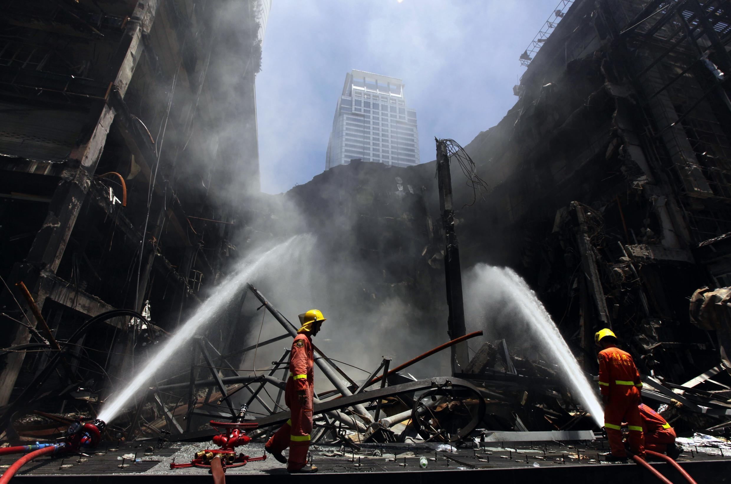 Fire-fighters douse the Central World shopping mall building in Bangkok