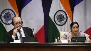 Indian External Affairs Minister Sushma Swaraj (R) with French Minister for Foreign Affairs Jean-Yves Le Drian in New Delhi on Friday