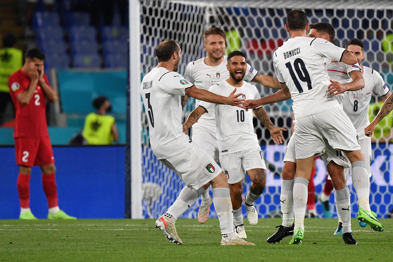 Lorenzo Insigne (C) celebrates Italy's third goal