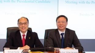 候任理大校長滕錦光(右)在校董會主席林大輝(中)陪同下露面。