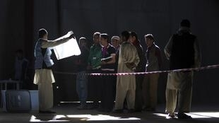 Afghan election worker shows an empty ballot box to the representatives of the candidates, Kabul, 18 September